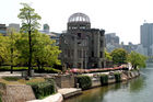 A-Bomb Dome with modern Hiroshima as background (blast epicentre is just behind the dome)